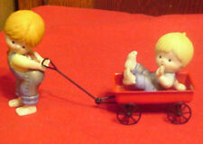 Enesco Country Cousins Katie Pulling Scooter in Wagon