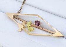 15k Antique Flower Brooch with one Rhodolite Garnet and 9k safety chain_two tone