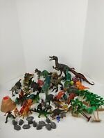 Lot Of 45 Assorted Plastic Dinosaur Toy Figures Various Sizes plus trees & rocks