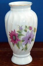 A Porcelain Vase with gilt rim and floral print - Parry and Vielle ?
