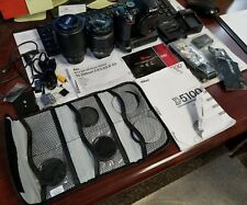 Nikon d5100 camera w/ 2 lenses, battery grip, lenses filters and accessories