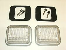 A PAIR OF LUCAS MGB REVERSE LAMP LENSES WITH GASKETS 1967 ONWARDS
