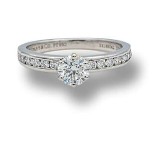 Tiffany & Co. Platinum Round Diamond Engagement Ring with Diam band .73 cts. Tot