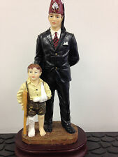 Shriner and child Figurine