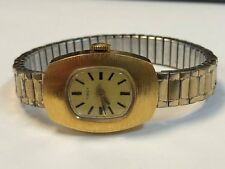 Ladies Gold Tone TIMEX Rectangular Wind Up Stretch Band Wrist Watch