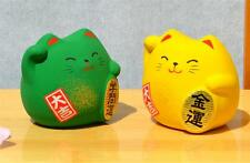 Two Maneki Neko Lucky green cat for success in education yellow for good fortune