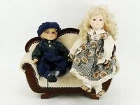 Altes Porzellankopfpuppen Pärchen auf Sofa Puppe Junge und Mädchen