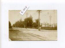 Everett MA Mass RPPC real photo street view, people, trolley tracks cobblestones