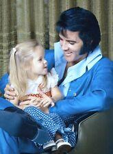 Elvis Presley , Elvis in a photo with Lisa Marie in 1970