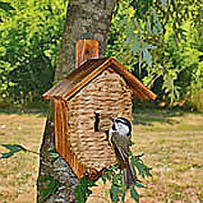 Grass birdhouse with roof