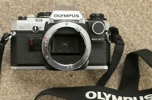 Olympus OM10 body complete with manual adapter, great condition