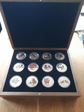 More details for perth mint lunar series ii and lll coloured silver 1oz coin set..