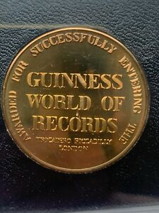 GUINNESS WORLD OF RECORDS MEDAL.AWARDED FOR SUCCESSFULLY ENTERING THE BOOK