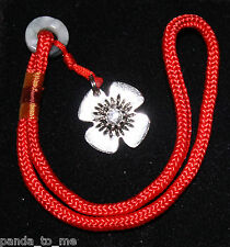 Flower Clasp Lock Opener on red cord, works on all European barrel locks & clips