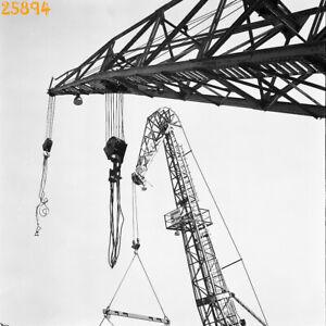 cranes in shipyard, abstract-unusual, industrial, vintage negative, 1960's