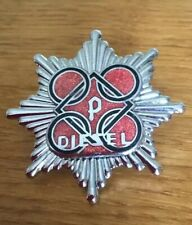 An old Perkins Diesel Fire Brigade, cap badge.