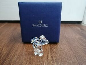 RARE SWAROVSKI KRIS BEAR WITH FLOWERS FIGURINE IS IN MINT CONDITION