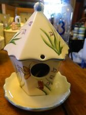 hanging ceramic bird house with butterflies and flowers