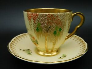 Carlton Ware Yellow Deco Lustre 'New Stork' Gilded Coffee Cup + Saucer.