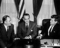 President John F. Kennedy at desk with VP Johnson and Humphrey Photo Print