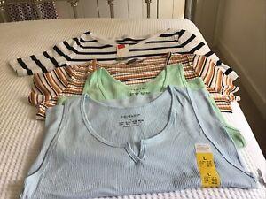 New, Ladies T shirts. bundle Size M/L