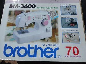 brother sewing machine,model BM-3600 70 stitch functions +new overlocker & books