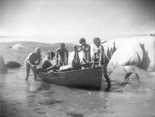 3 small negatives - Group of six - young men & women - with rowing boat on beach