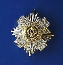 New 18ct Gold SCOTS GUARDS Brooch set with diamonds and an amethyst.