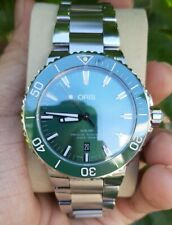 NEW ORIS AQUIS DATE GREEN DIAL AND CERAMIC BEZEL 7730 AUTOMATIC MENS WATCH
