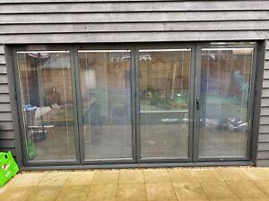 4m x 2.1m, Quality Aluminium Bi fold Patio Doors inc Glass 4 panels. WITH BLINDS