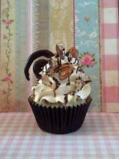 TURTLE FAKE CUPCAKE WITH PECANS AND CHOCOLATE SWIRL CANDY FOR PHOTO PROPS DECOR
