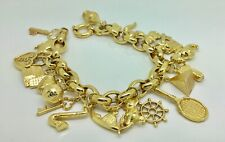 """9ct Gold 8"""" charm bracelet set with 23charms"""