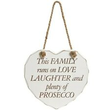 Wooden heart hanging plaque - This family runs on love, laughter...