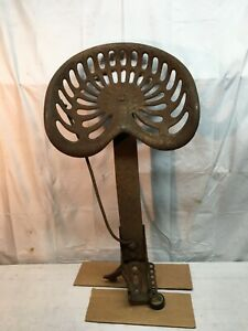 Vintage Original Antique Cast Iron CHAMPION Tractor Seat With Mounting Bracket