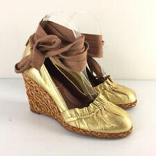 New BCBGMaxAzria 7.5 Gold Leather Wedge Espadrille Ankle Tie Heels Anthropologie