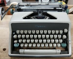 Vintage Olympia SM-8 portable typewriter Techno font type - new ribbon, oiled
