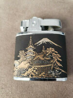 Vintage Firefly Cigarette Lighter. Japanese Scenary in black and gold.