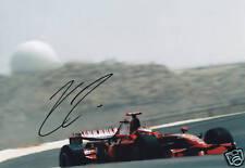 Famous F1 Driver Kimi Raikkonen signed photo.