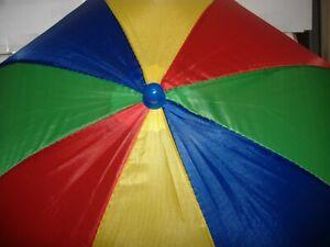 UMBRELLA HAT RED, GREEN,BLUE,YELLOW KNOB ON TOP IS BLUE GOOD IN SUN & RAIN