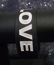 Wonderful black rubber style wrist band with the word Love