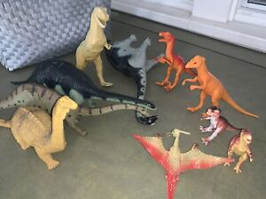 12. plastic Dinosaurs , and  3 hand Dinosaurs Puppets  all together 15 Dinos!!