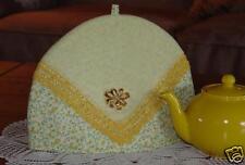 Tea Cozy with vintage handkerchief and pin