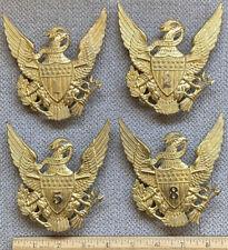 Four Replica M1881 Cavalry Helmet Plates.