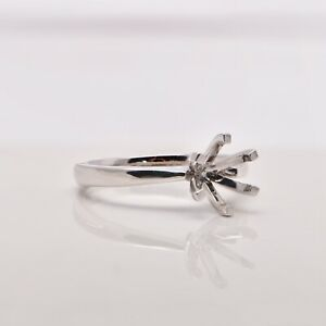 Engagement ring six claw solitaire setting in 18ct white gold