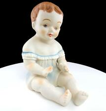 "GERMAN BISQUE BLUE EYED BLUE OUTFIT SITTING 7"" PIANO BABY"
