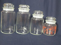 Vintage Set of 4 clear glass canisters tight fitting lids