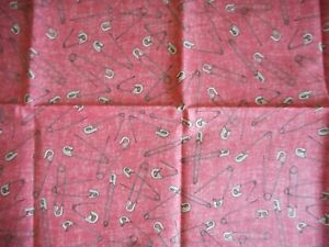 Safety pins on light red background Mrs. Sew & Sew by Dan Morris RJR Fabrics