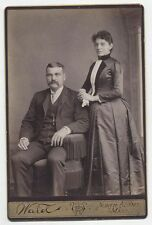 CABINET CARD GENTLEMAN SEATED CHAIR WITH FRINGE,WOMAN STANDING. N. ADAMS, MASS
