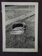 1940 ABSTRACT PHOTO OF FISH BASKET WITH FISH AND POLE LYING IN THE GRASS