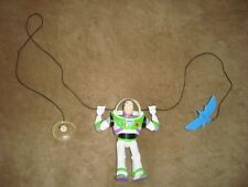 Disney Toy Story Buzz Lightyear Figure attached to a sting w/ suction cup Mattel